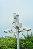 Una cámara de la foto a la seguridad de la vida y a la propiedad de la gente Imagen de archivo libre de regalías