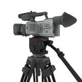 Una cámara de vídeo en el trípode Fotos de archivo libres de regalías