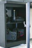 Una cámara del dslr en drybox Imágenes de archivo libres de regalías