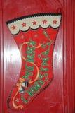Una calza rossa di Natale pronta per riempire! fotografia stock
