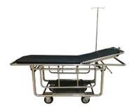 Una cama de hospital aislada en blanco Imágenes de archivo libres de regalías