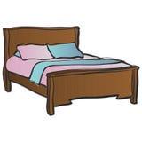 Una cama de madera doble Fotografía de archivo