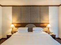 Una camera da letto di eleganza Fotografia Stock