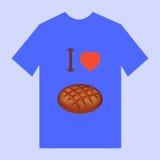 Una camiseta azul con la imagen del buñuelo y de la magdalena del pan Fotografía de archivo