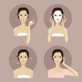 Una cara de la muchacha con la máscara y el maquillaje faciales fotografía de archivo libre de regalías