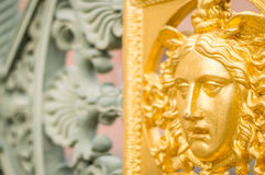 Una cara de oro del metal Foto de archivo libre de regalías