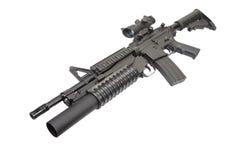 Una carabina M4A1 fornita di lanciagranate M203 Immagine Stock
