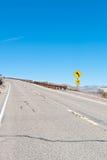 Una carretera del desierto Foto de archivo libre de regalías