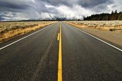 Una carretera vacía en el parque nacional de Teton Imagen de archivo