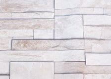Una carta da parati con le strutture di pietra della roccia come fondo per riferimento Fotografia Stock