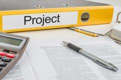 Una cartella con il progetto dell'etichetta Immagini Stock