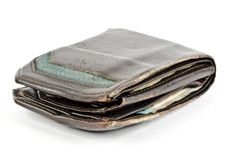 Una cartera de cuero para hombre resistida con el dinero en él foto de archivo libre de regalías