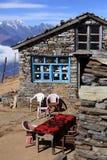 Una casa di pietra in montagna Fotografia Stock