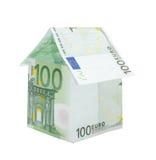 Una casa hecha de cuentas euro Fotografía de archivo libre de regalías