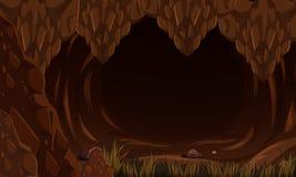 Una caverna spaventosa di buio della roccia Immagine Stock