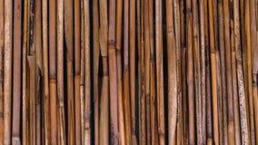 Una cerca de la paja en un estilo tropical foto de archivo libre de regalías
