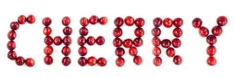 Una cereza de la palabra composited de cerezas foto de archivo libre de regalías