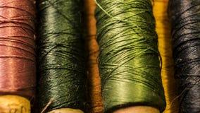 Una certa fine del colpo delle bobine del filato cucirino su Immagini Stock