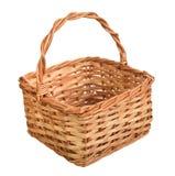 Una cesta de mimbre con la manija. Fotografía de archivo