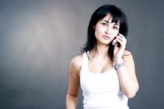 Una charla sobre el teléfono Foto de archivo libre de regalías