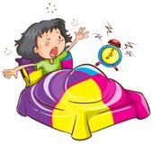 Una chica joven con un despertador Imágenes de archivo libres de regalías