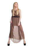 Una chica joven hermosa en un vestido imágenes de archivo libres de regalías