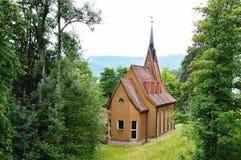 Una chiesa di tre housetop Immagine Stock Libera da Diritti