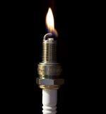 Una chispa del enchufe con una llama Fotografía de archivo libre de regalías