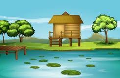 Una choza en el riverbank ilustración del vector
