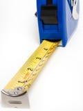 Una cinta métrica para conseguir exactitud Imágenes de archivo libres de regalías