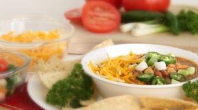 Una ciotola di minestra del peperoncino rosso caldo Fotografia Stock