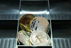 una colección de cryptocurrency en un lockbox imagenes de archivo