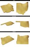 Una colección de formas de oro de los estados americanos Ohio, Oklahoma, Oregon de los E.E.U.U. Fotografía de archivo libre de regalías