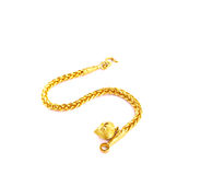 Una collana dorata isolata su fondo bianco Immagine Stock