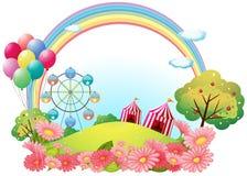 Una collina con le tende di circo, i palloni e una ruota di ferris illustrazione di stock