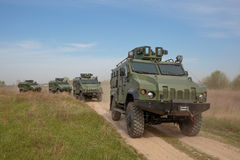 Una colonna dei veicoli alla dimostrazione Fotografia Stock Libera da Diritti