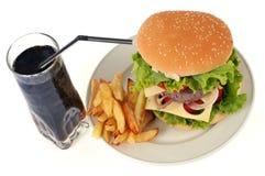 Una comida con una bebida de los alimentos de preparación rápida foto de archivo libre de regalías