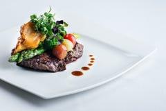 Una comida deliciosa - negro Angus del filete de Ribeye con el espárrago Imágenes de archivo libres de regalías
