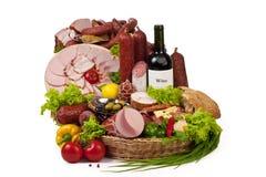 Una composición de la carne y de los vehículos con el vino Fotografía de archivo libre de regalías