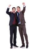 Una conquista dei due uomini di affari Fotografia Stock