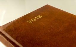 Una copertura dell'organizzatore dell'ufficio di 2016 calendari Immagini Stock