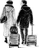 Una coppia con le valigie in un viaggio Fotografie Stock