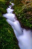 Una corriente del agua caliente en Islandia cerca de Akureyri Imagenes de archivo