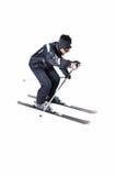 Una corsa con gli sci maschio dello sciatore con l'attrezzatura piena su un fondo bianco Fotografia Stock Libera da Diritti