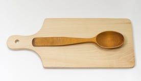 Una cuchara de madera en el tablero Imagen de archivo
