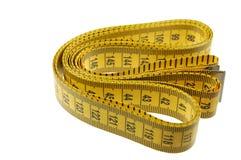 Una cucitrice o sarti che misura nastro Fotografia Stock Libera da Diritti