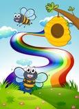 Una cumbre con las abejas y una colmena cerca del arco iris ilustración del vector