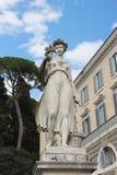 Una de las cuatro esculturas alegóricas en Piazza del Popolo Imágenes de archivo libres de regalías