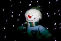 Una decoración de las tarjetas de Navidad y una tierra trasera Imagen de archivo
