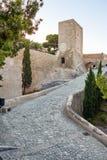 Una delle torri Santa Barbara Castle, Alicante, Spagna Fotografia Stock